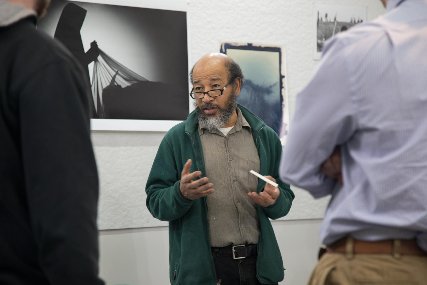 Albert Chong lecturing about photography