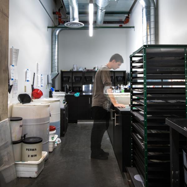 student in darkroom