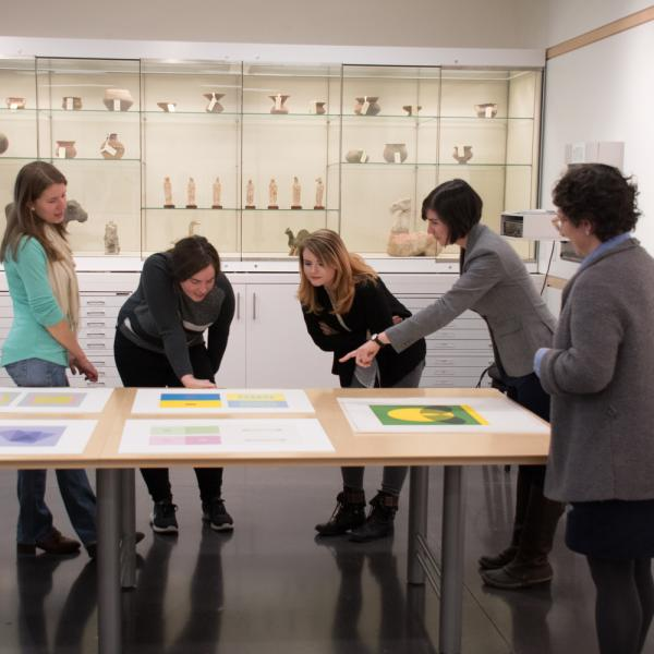 Assistant Professor of Art History, Brianne Cohen and Museum Staff, Hope Saska, in the CU Art Museum Collection Study Center examine and prepare objects for study and display.