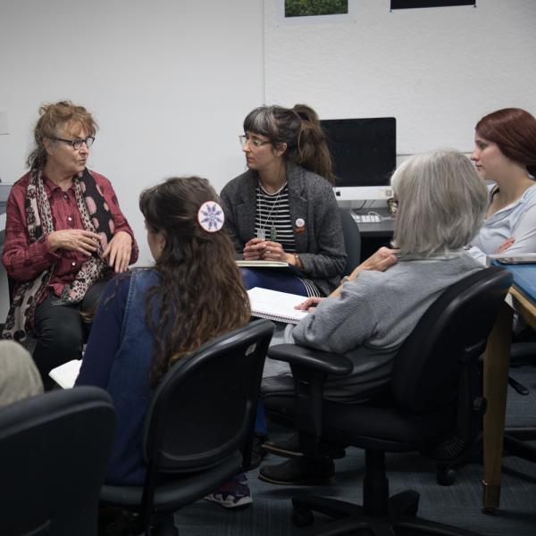 Students receiving instruction from professor Melanie Walker
