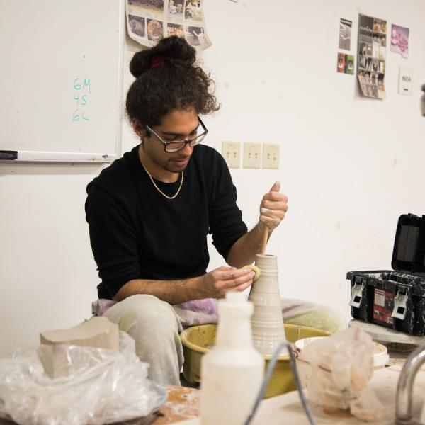 Ceramics student working on large-scale artwork