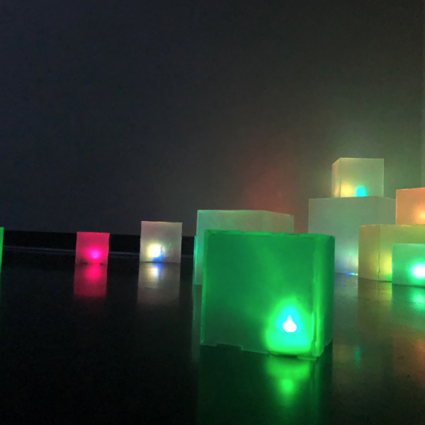 """Hailey Carlson. """"Digital Spill,""""Self-lit acrylic voxels. 4"""", 6"""", and 10"""" cubes. 2019"""