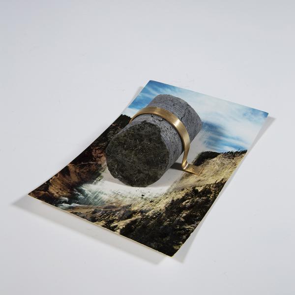 """Anthropogenic Monument 1,"" Erased Western postcard, mineral core, bronze, ink 3.5"" x 5"" x 1.5"" 2019"