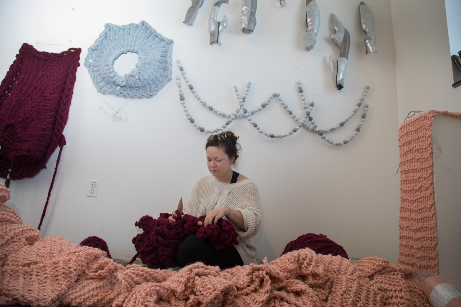 MFA candidate and graduate student, Meghan Chase, knits for her MFA thesis project in her studio.
