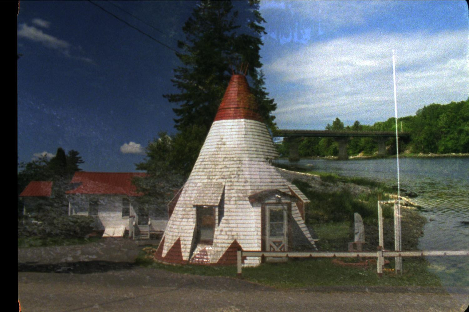 Film still with teepee house