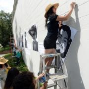 Jasmine Baetz installing artwork