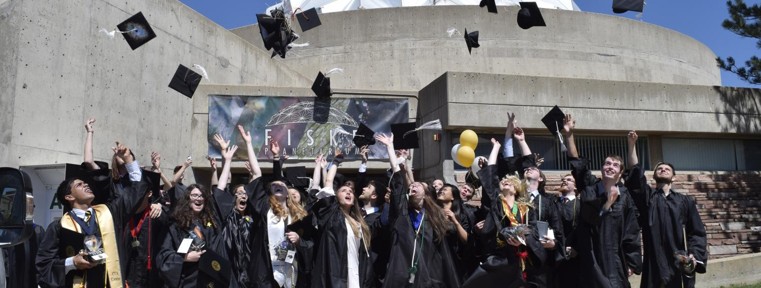 Photograph of APS graduates throwing hats