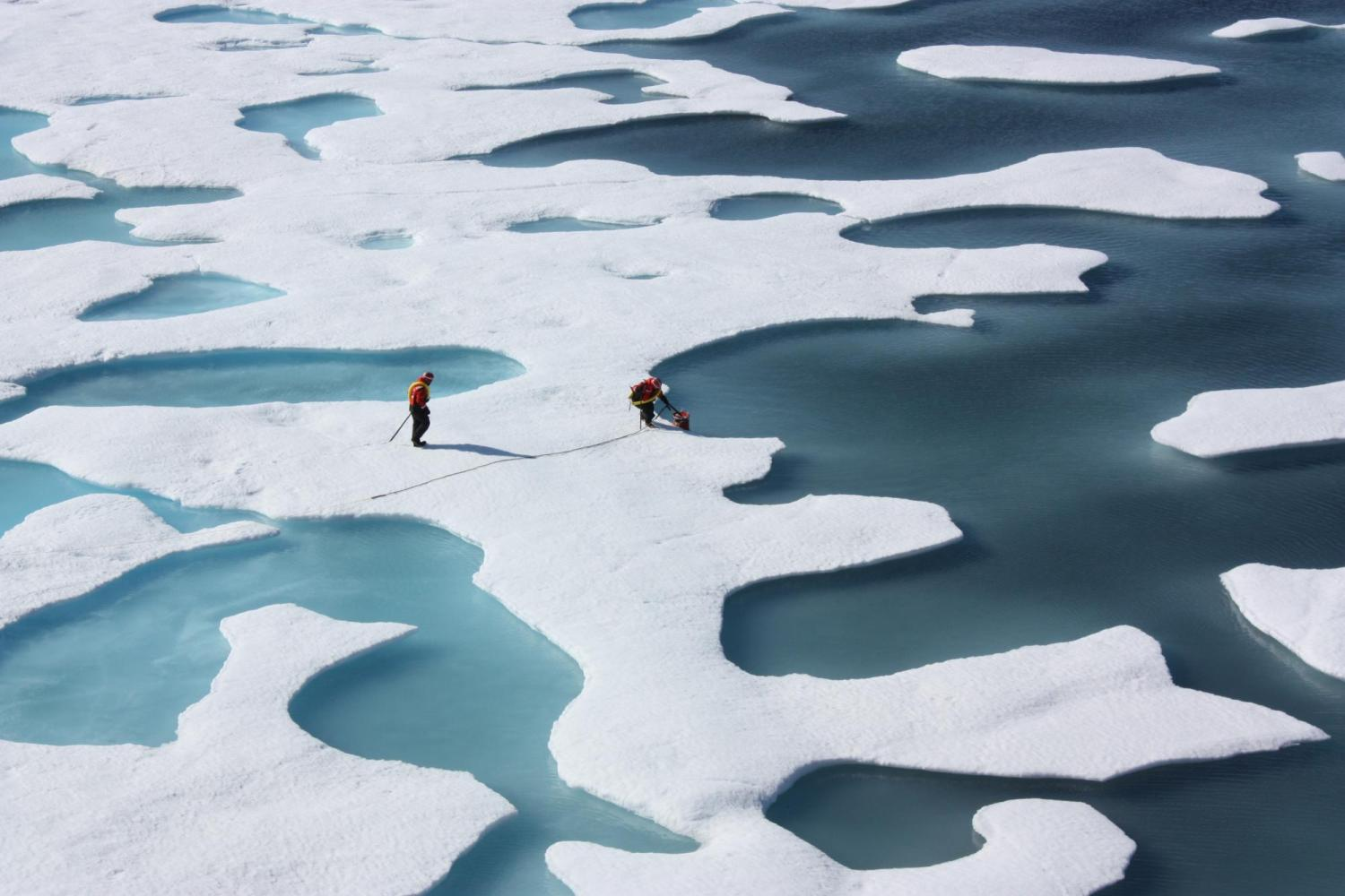 Photograph of two researchers on the ice