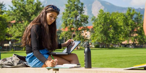 Student studying in Farrand Field