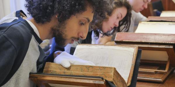 Student reading an ancient text
