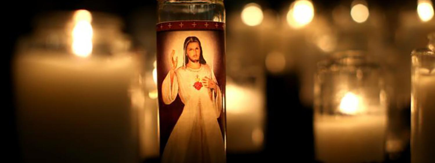 A candle with the image of Jesus Christ is displayed inside St. Patrick Church on April 8, 2016 in San Francisco, California.