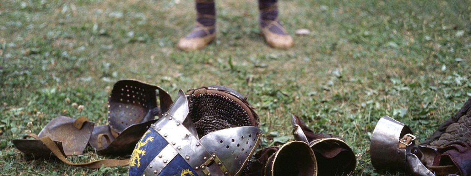 Stock photo of medieval armor on the grass.