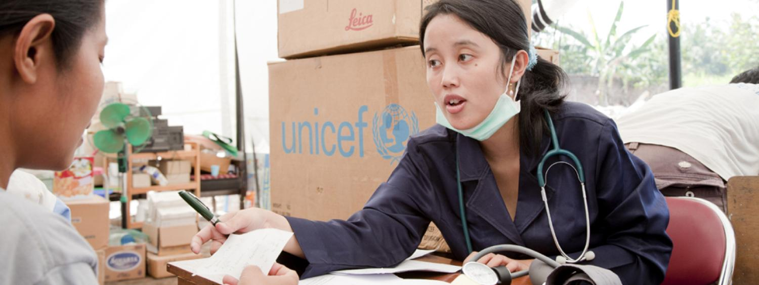 A health professional helps distribute supplies for UNICEF.
