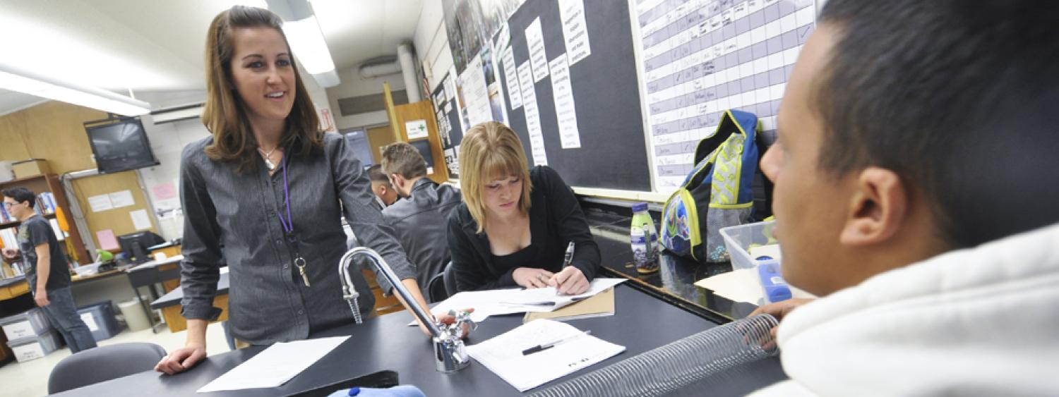A student teacher works with high schoolers.