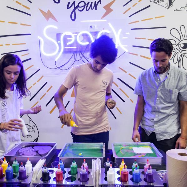 students paint at a spark lab