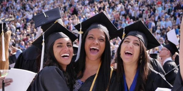 students at graduation posing for photo