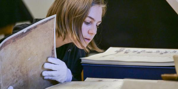 Student studies historical manuscrpit