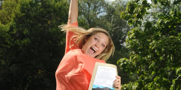 Student jumping with excitement