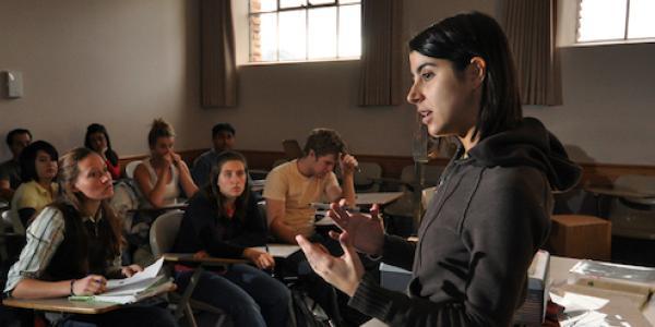 A Spanish instructor teaches a full classroom.