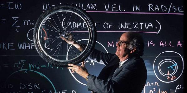 physics faculty spinning bicycle wheel