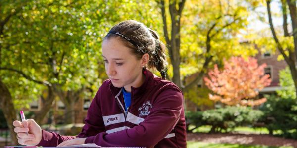 Student studies at picnic table