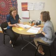 academic coach and student discuss study skills plan
