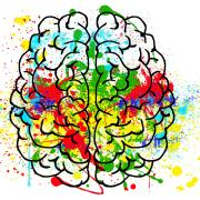 brain outline with multi-colored paint splotches