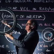 physics faculty spins bicycle wheel