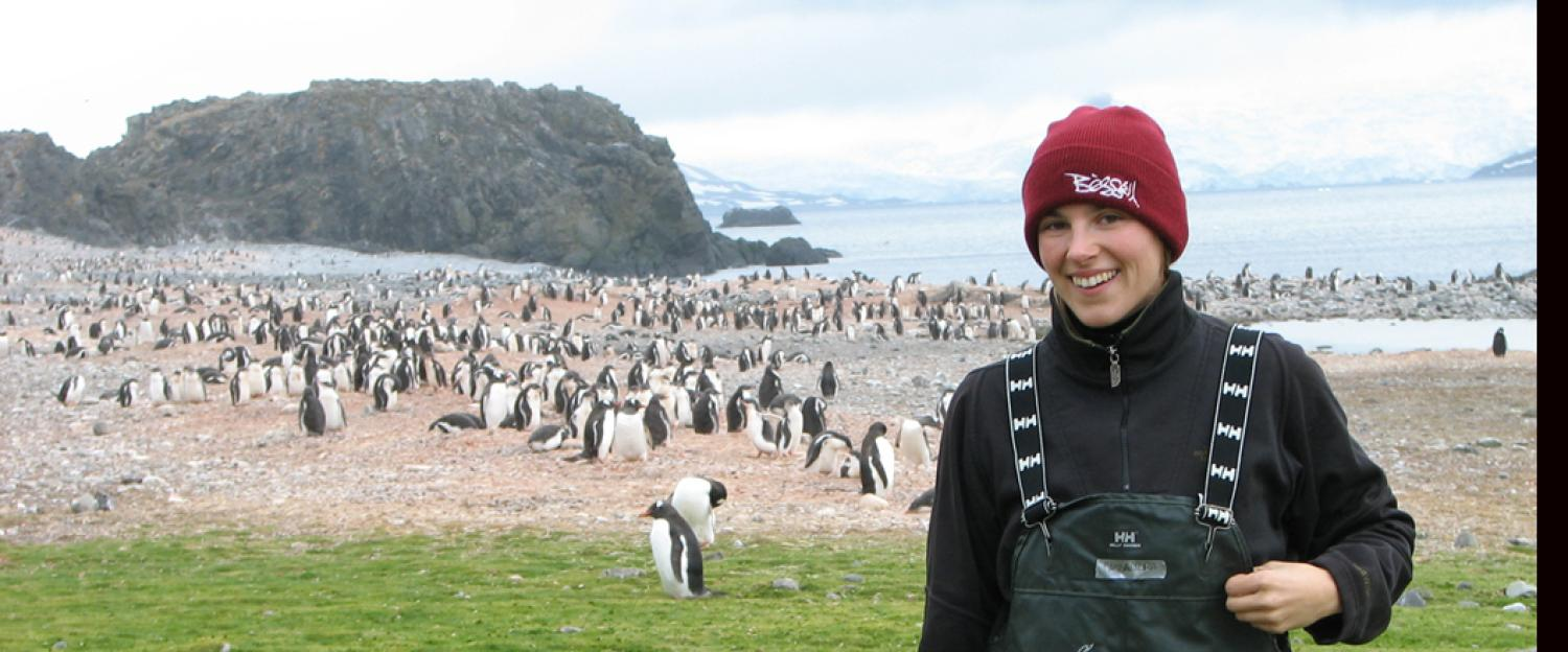 Cassandra in Antartica with a Penguin crop in the background.