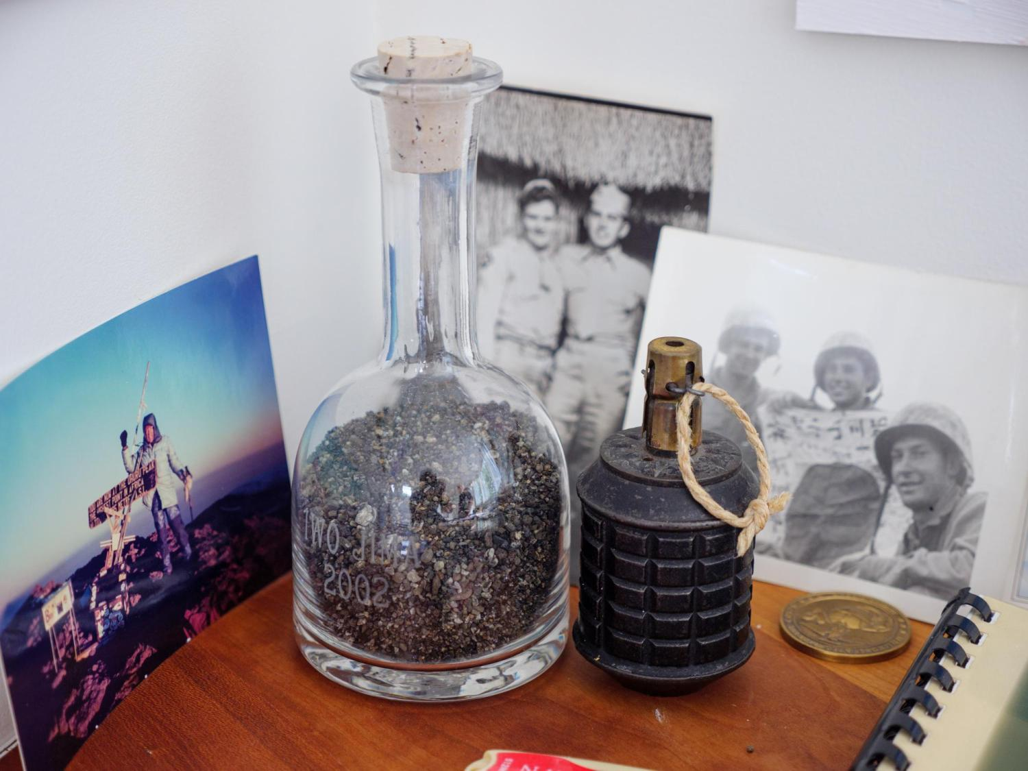 Sand of Iwo Jima and a hand grenade sitting on the desk of Dick Jessor.