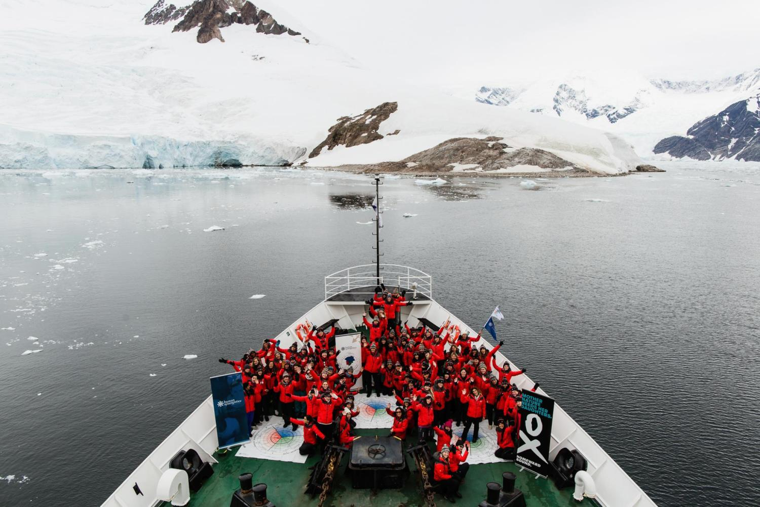 Homeword Bound women group together on a ship in Antartica.