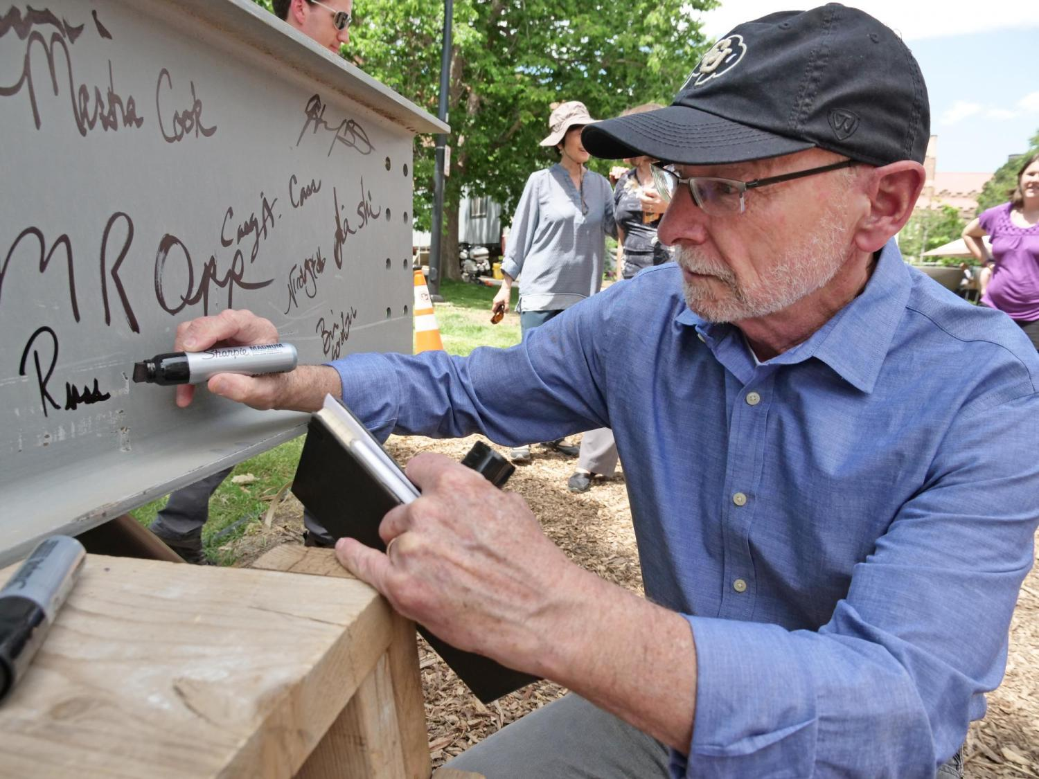 signing the last beam