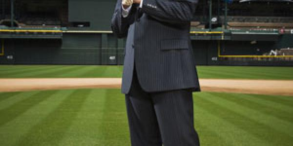CU alumnus Tom Garfinkel stands on the mound of Chase Field, the home of the Arizona Diamondbacks for whom he is the the executive vice president and chief operating officer.