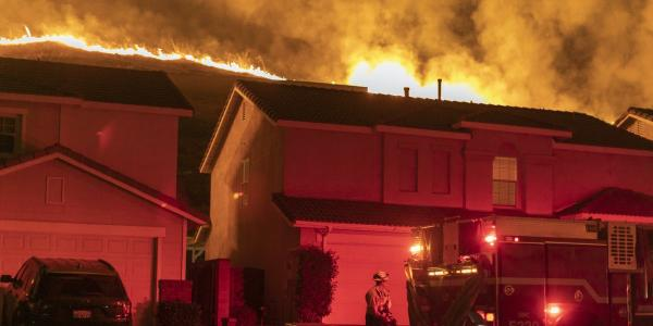 Flames approach houses during the Blue Ridge Fire on Oct. 27, 2020 in Chino Hills, California.