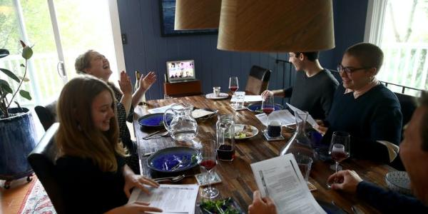 A Jewish family gathers in person and over video conferencing for Passover celebrations in 2020. Ezra Shaw/Getty Images