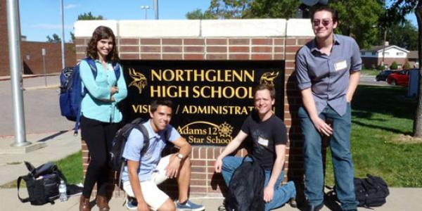 Literary Buffs (left to right) Sydney Chinowski, André Gianfrancesco, Sean Guerdian and Lukas DeVries strike a pose outside Northglenn High School, where they coached future college students on preparing college-level papers.