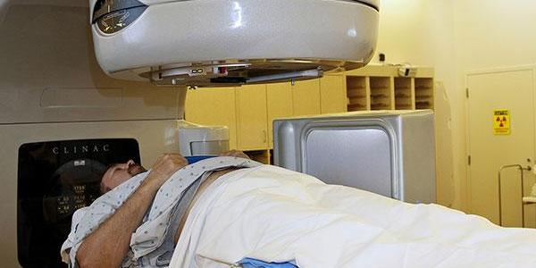 A patient prepares to undergo radiation therapy.