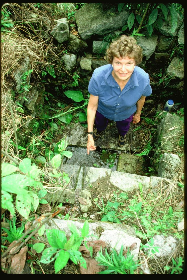 Ruth Wright points to a water channel recently discovered by the couple's team. Photo courtesy of Ruth and Ken Wright.