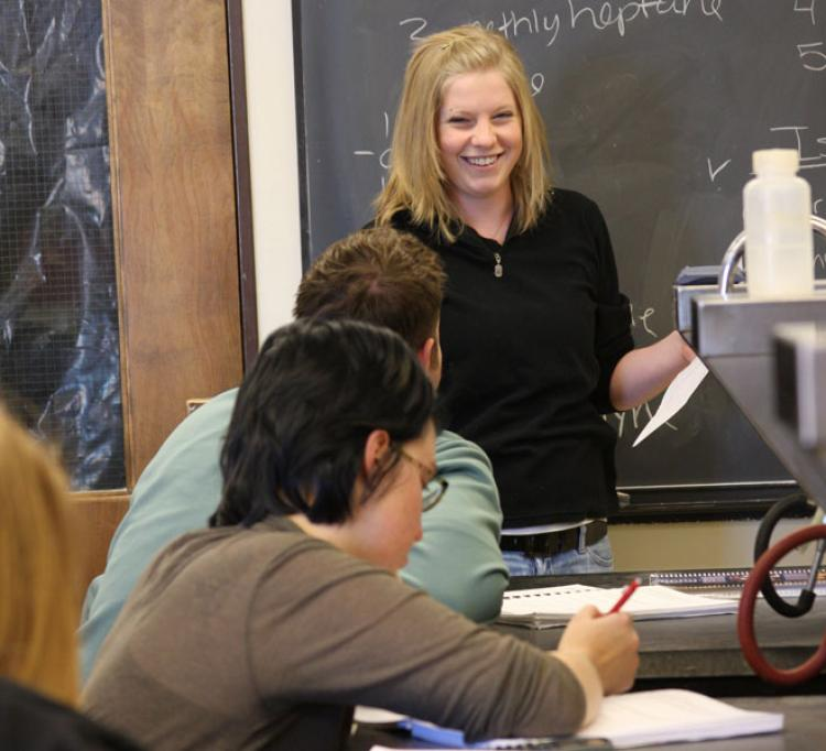 Sarah Berger offers instruction to students in a University of Colorado biochemistry lab.