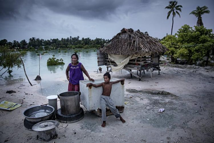 Rising sea levels are making it harder to live in the low-lying islands of Kiribati. Salt water has infiltrated cropland and fresh water supplies, but for many people, migration is impossible. Jonas Gratzer/LightRocket via Getty Images