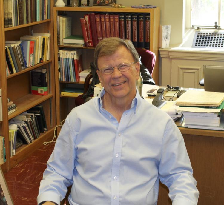 Markusen sitting in his office