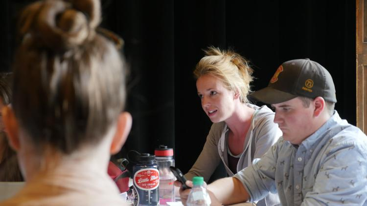 Actor Kelsey Didion at a table reading of Douglas Langworthy's translation of Henry VI, Part 2.Jackson Xia for CU Presents.