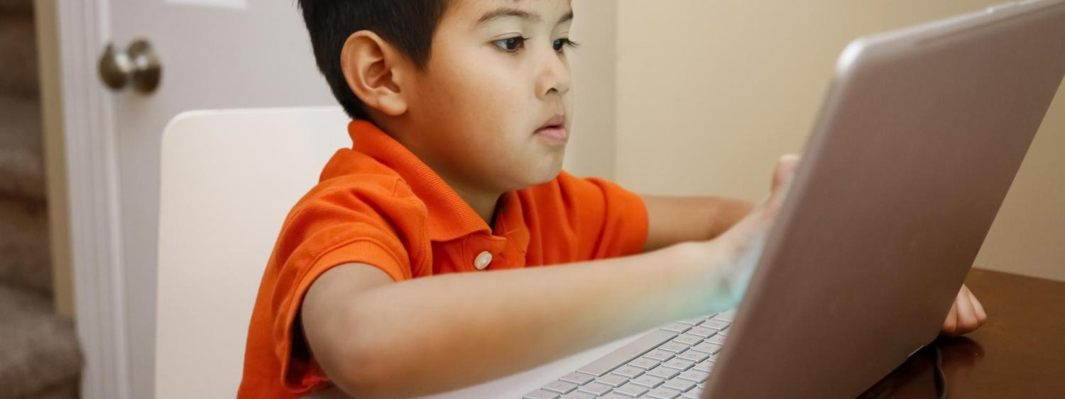 Child in front of a laptop