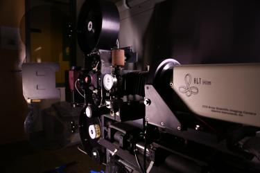 """Meet """"Thumper,"""" the 16mm and 35mm Film scanner used on """"Babe Pig in the City"""" and other productions. The scanner is a modified Oxberry Optical Printer consisting of a Projector Movement and A liquid Cooled 4K Camera Head. Each Film frame is scanned 4 times at a 4K resolution in Red, Green, and Blue, as well as Alpha Channel for dust removal. This design is crucial for film preservation and color separation elements for storage. Photo by Andrew Busti."""