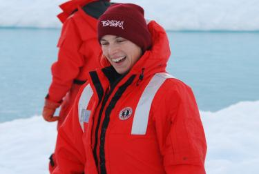 Cassandra smiling while on expedition in the Antarctic.