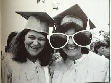 Janet Pollack poses with funny glasses on her graduation day in 1984. The woman on the left is Barb Keller Richard (Journ '84).