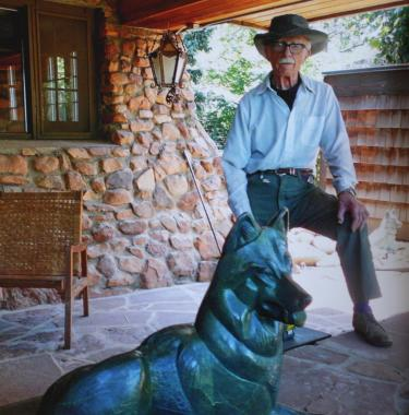 Lynn Wolfe with his Wolf Sculpture
