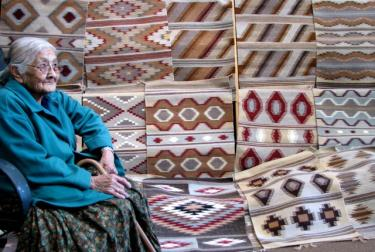 Mae Morgan, a Navajo weaver, is one of several weavers who produces rugs for an auction that raises funds for the Museum of Natural History at CU-Boulder. Photo courtesy of Harry Jackson Clark Sr.