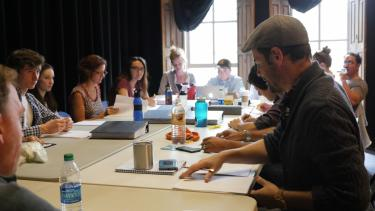 Geoffrey Kent leads a table reading of Douglas Langworthy's translation of Henry VI, Part 2. Photo by Jackson Xia for CU Presents.