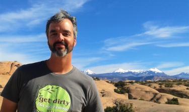 Scott Ferrenberg, who earned his Ph.D. in biology from CU-Boulder, is shown near Moab, Utah, where he and CU  alumna Sasha Reed conducted a groundbreaking study on biocrust. Photo courtesy of Scott Ferrenberg.